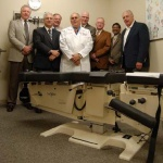 Cox Technic presents table to Palmer College of Chiropractic
