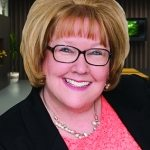 KMC University's Kathy Mills Chang named Person of the Year at Parker Seminars Las Vegas