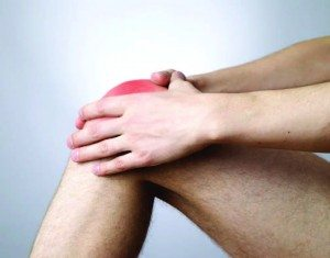 Hands holding red knee, homeopathy helps soft-tissue injuries