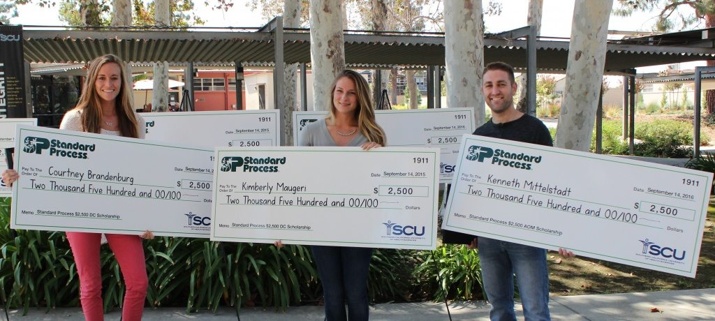 Southern California University of Health Sciences students Courtney Brandenburg (left), Kimberly Maugeri and Kenneth Mittelstadt, accept their $2,500 Standard Process scholarships.