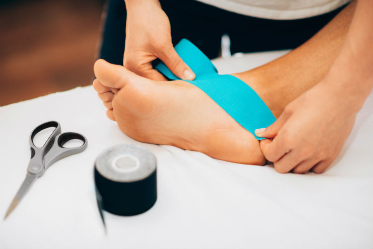 In many ways, kinesiology tape and foot orthotics share the same goals: to control and encourage proper movement patterns.