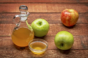 A bottle of apple cider vinegar. Discover the many apple cider vinegar benefits.