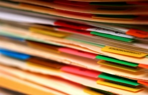 A stack of files that people are donating medical records to research with