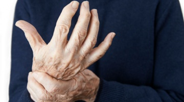 A man searching for a topical for arthritis
