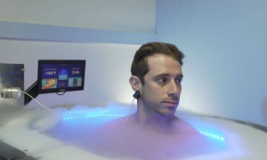 A person enjoying a chiropractic cryotherapy session in a practice