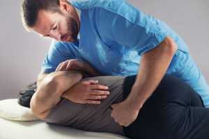 A chiroprator performing the chiropractic zone technique on a patient