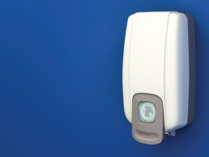 A hand sanitizer dispenser showing the importance of chiropractic hand hygiene