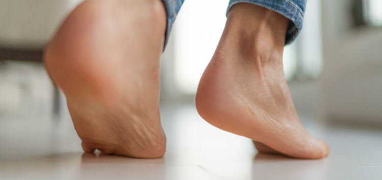 A woman suffering from plantar fasciitis