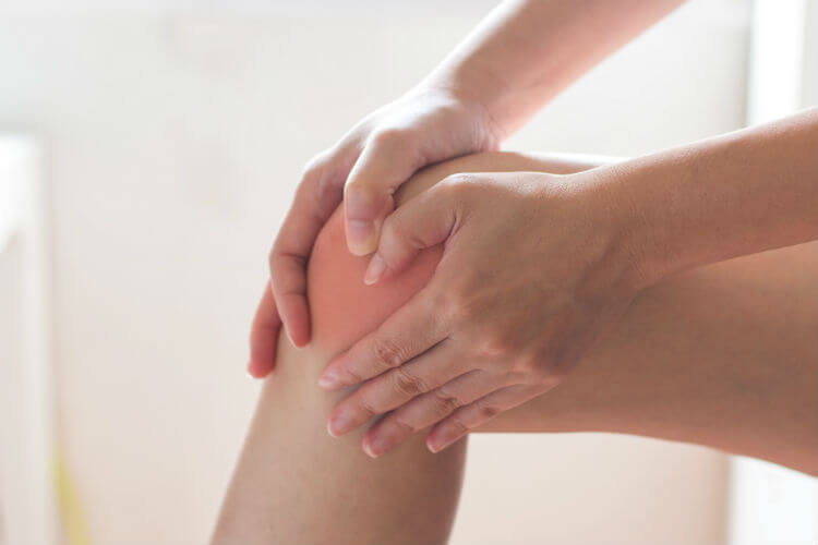 A woman who is in pain and needs a chiropractic techniqued with topicals to relieve her pain