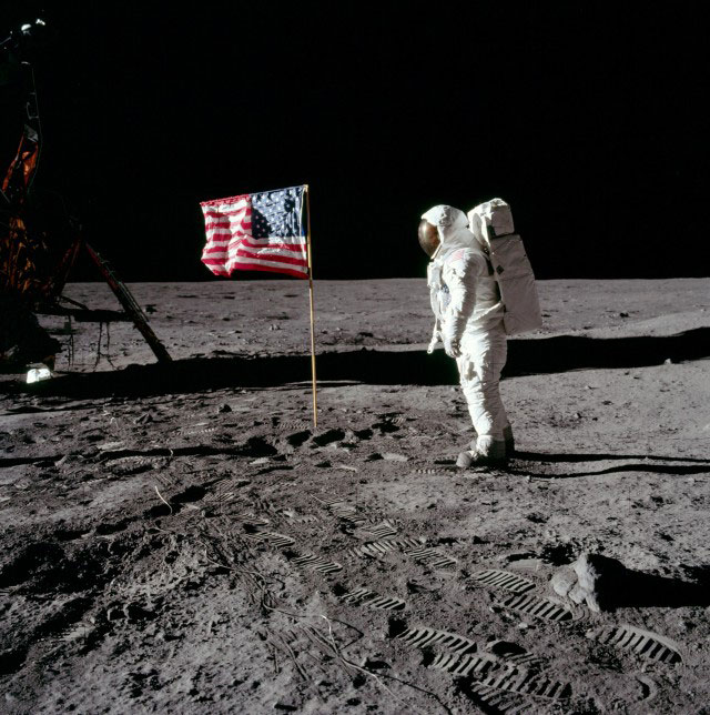 Neil Armstrong becomes the first man to walk on the surface of the Moon