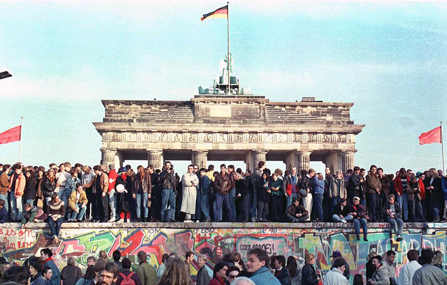 The Berlin Wall is torn down