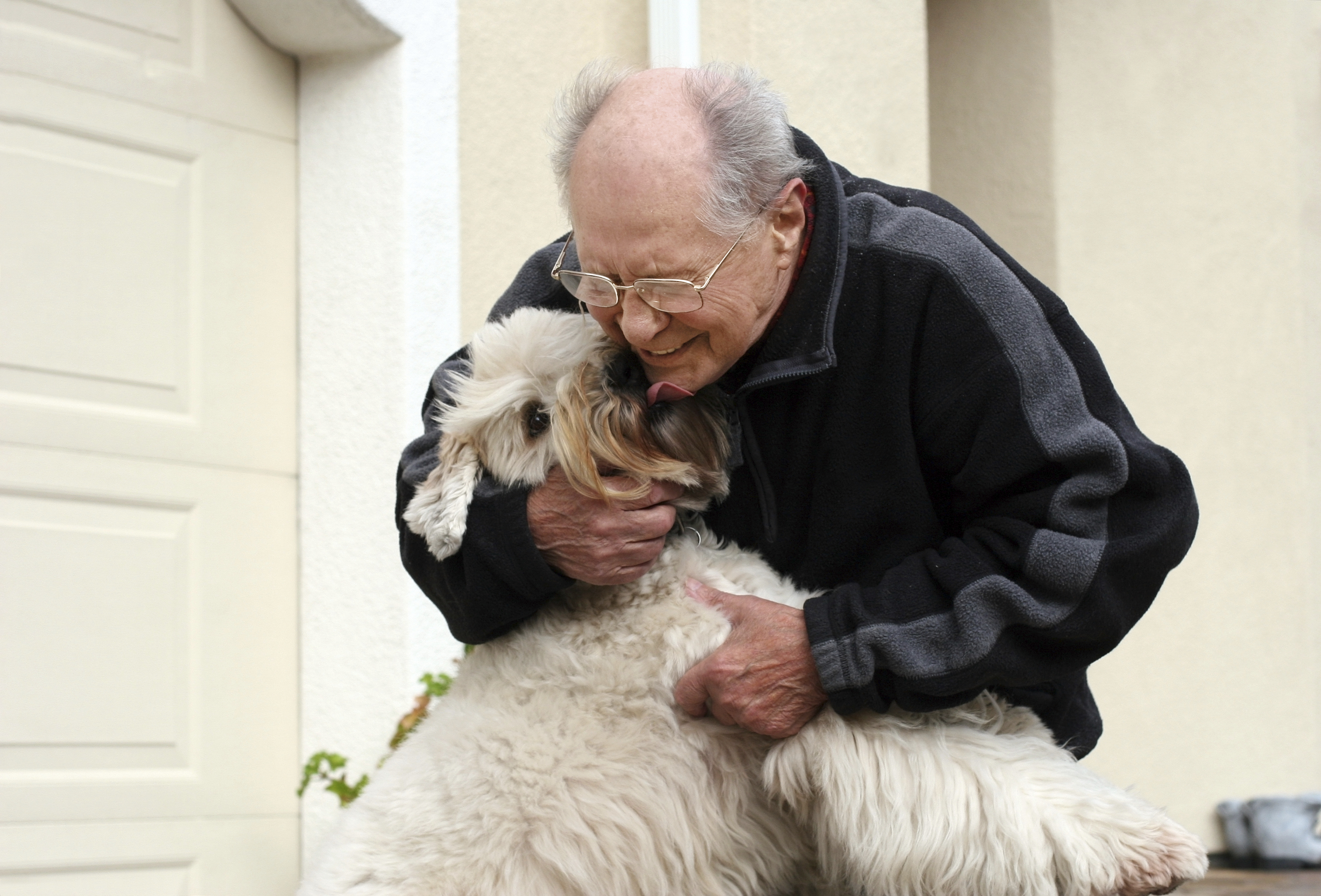 Aging man with dog