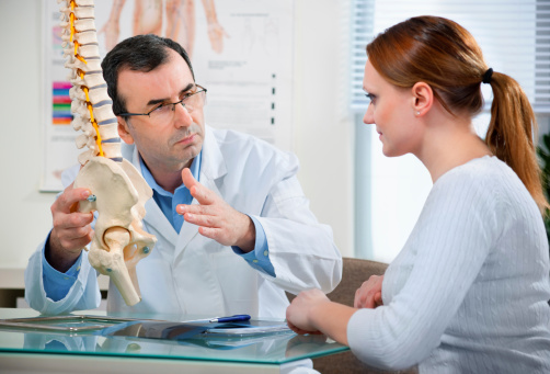 Doctor explaining to patient ankylosing spondylitis