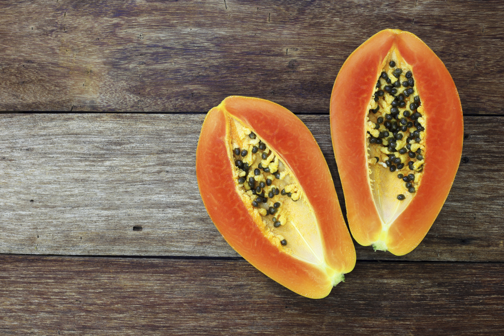 Papaya on table - proteolytic enzyme supplements