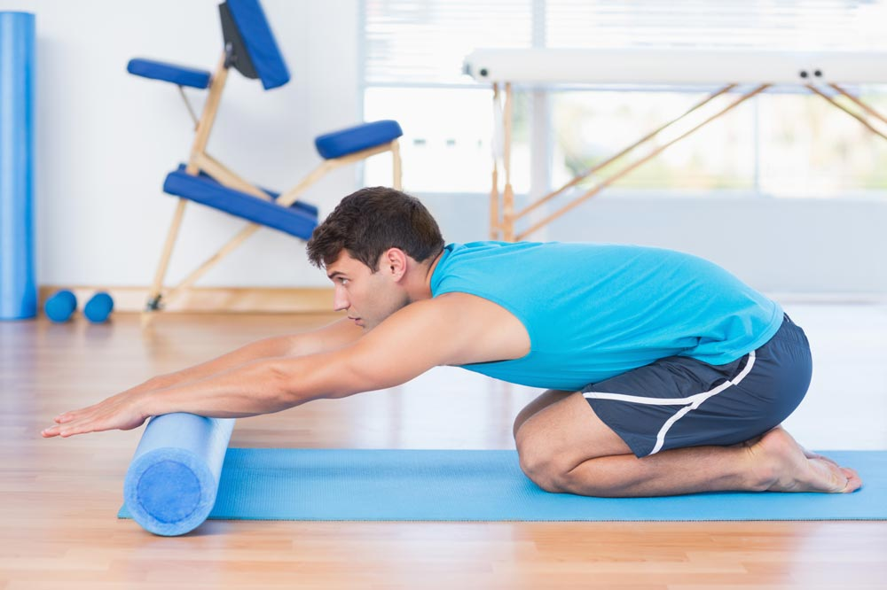 Man-using-foam-roller-on-self