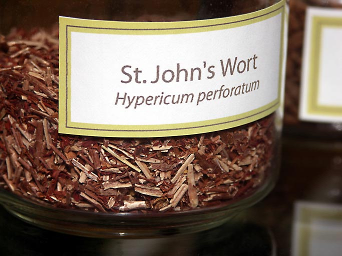St. John's wort dried in jar with label