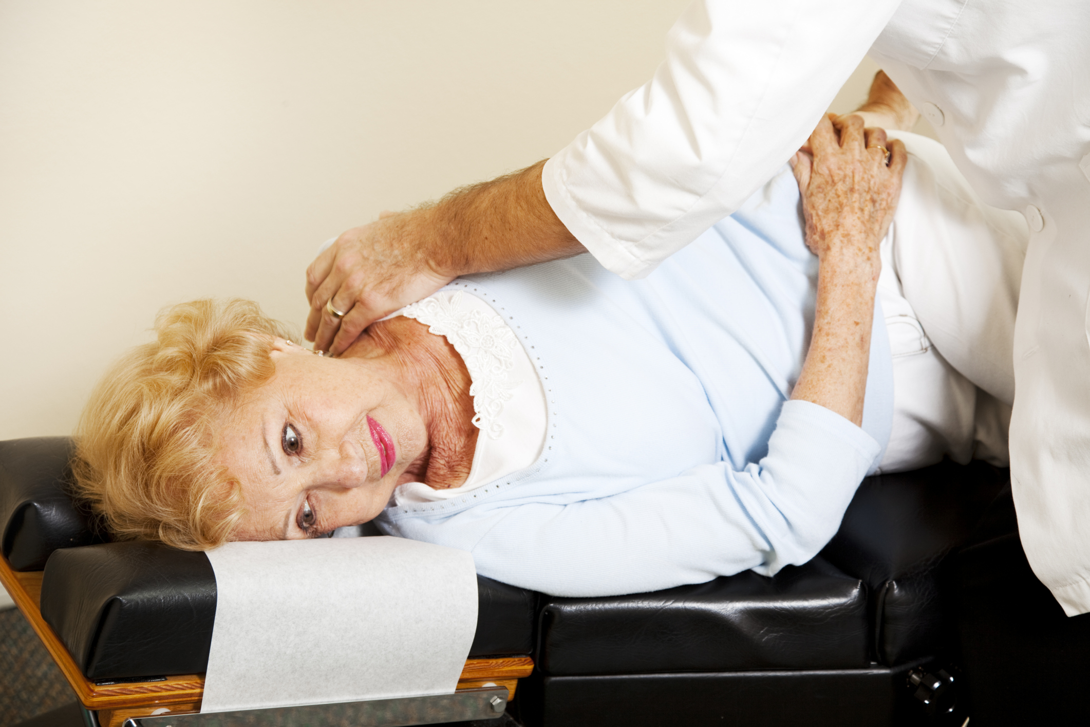 Common chiropractic table with woman