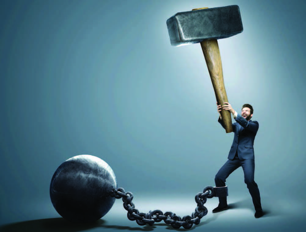 Man with giant hammer about to hit ball and chain attached to his leg