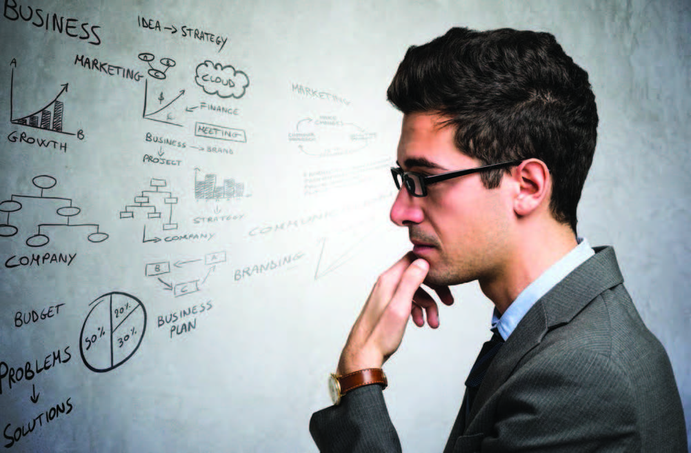Man looking at whiteboard creating your next practice