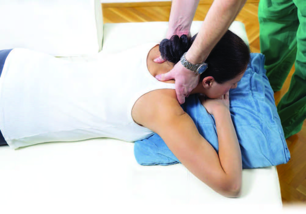 Woman laying down on chiropractic table.