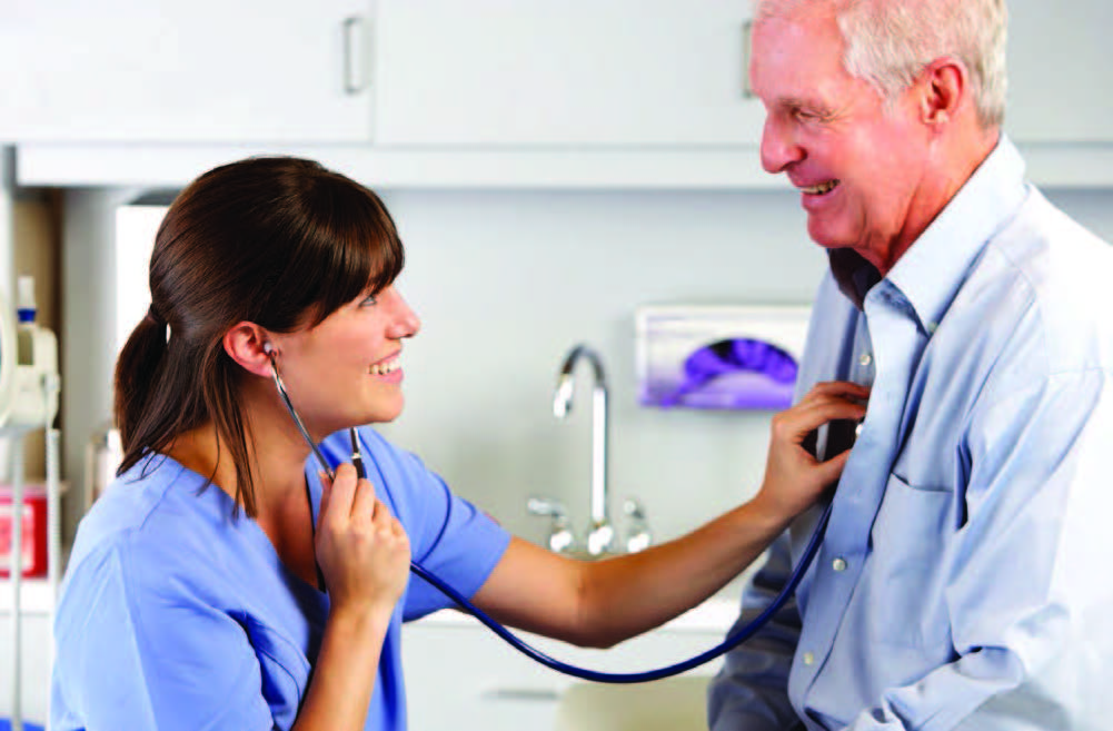 Physician extender listening to patient heart