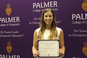 Brittany Gentile, who attends Palmer Chiropractic College West in San Jose, California, receives a $2,500 scholarship from Standard Process.